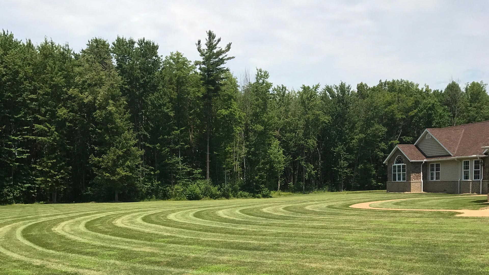 Professionally mowed lawn with stripes at a large property in Ashtabula, OH.