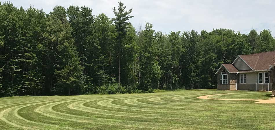 A proper aeration and overseeding in a lawn of this Conneaut property.