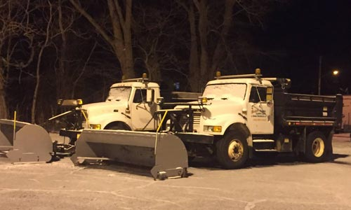Two of our snow plows prepared to go out and clear our client's properties in Ashtabula.